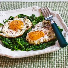 Eggs Fried in Olive Oil with Wilted Greens and Sumac; so delicious and what a healthy way to start out the day!  [from KalynsKitchen.com] #DeliciouslyHealthyLowCarb