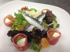 Prosciutto wrapped Baby Heirloom Tomato, Basil and Mozzarella Salad with White Anchovies, Kalamata Olives and Roasted Garlic Vinegraitte