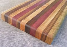 What a gorgeous cutting board.   DIY with three different hardwoods.  (maple, purpleheart and curly maple)