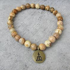 NETRA Ethnic bracelet for men, small stone beads Jaspe, Buddha pendant bronze, bracelet of friendship, zen, meditation, This stretch bracelet in semi precious stone beads is a jewelry that can be worn every day Men or women. It will match with other bracelets you already have or that you can find in my shop, to perfect the stack of jewelry to your ethnic fashionable wrist.  This mala style bracelet in semi precious gemstone beads from Jasper Landscape (beige and brown) can be used for yoga