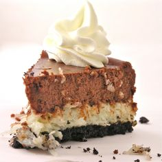 Creamy Coconut Cheesecake - Chewy layers of coconut covered in dark chocolate cheesecake make this dessert irresistible!