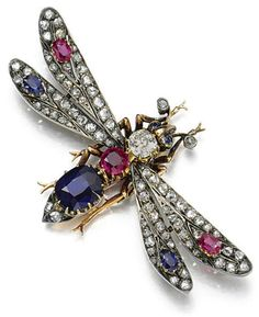 FORMERLY IN THE COLLECTION OF THE HON. MARGARET DAWNAY, LADY-IN-WAITING TO QUEEN ALEXANDRA:   RUBY, SAPPHIRE AND DIAMOND BROOCH, LATE 19TH CENTURY. Designed as a winged insect, set with oval and cushion-shaped sapphires and rubies, circular-cut and rose diamonds, French assay marks, detachable brooch fitting, pendant loop, sprung hair fitting, fitted case, accompanied by a hand-written note from Queen Alexandra 'With all good wishes for every happiness to good luck from Alexandra'.