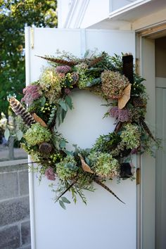 Door Wreath with Hydrangea and Pheasant Feathers from @Bella Rosa