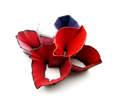 Flora Vagi  Brooch: Things explode in a garden series- Redpink 2012  Wood, acrylic paint, steel, semi-precious stone