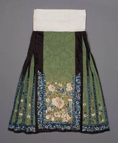 Woman's domestic skirt (qun)  Chinese (Han), Qing dynasty, mid-19th century   China  Dimensions  94 x 73.5 cm (37 x 28 15/16 in.)  Medium or Technique  Silk damask with silk floss embroidery and couched gold-wrapped thread.  MFA museum, boston.