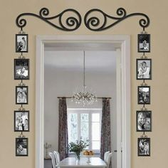 DIY photo frames around a doorway. Seems like a easy way to brighten up a room.