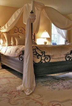 Dad could totally make our bed frame and screw the metal design into the corner..Except I would want the canopy to be squared on top...