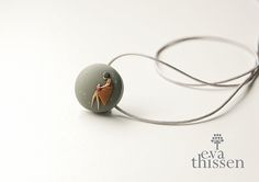 The Reader. Hand made Polymer Clay Pendant by Eva Thissen.