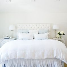 white bedroom tufted headboard 2 different nightstands