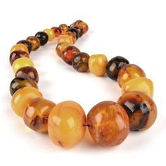 Antique Large Amber Nugget Beads Necklace - Huge genuine amber nugget beads from the Baltic Sea, semi-polished and strung onto thread which has been knotted in between each big stone, make up this extravagant piece of jewelry for your neck. Each bead has its own inherent beauty; some have bright inclusions, others have swirls of opaqueness, some have dark spots, some have dimples, etc.
