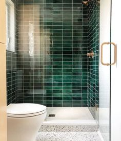 We can't stop staring at this bathroom inspired by the hotel in Barcelona. An emerald green statement wall wins us over every time. Photography by 💚 - Subway Tile - Bluegrass. Mosaic Bathroom, Bathroom Floor Tiles, Small Bathroom, Green Tile Bathrooms, Light Bathroom, Modern Bathroom, Bathroom Interior Design, Home Interior, Interior Modern