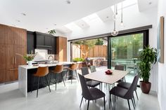 Dining area and kitchen by Madeleine Design Group, part of an award-winning Luxury Laneway home renovation in Vancouver, BC.