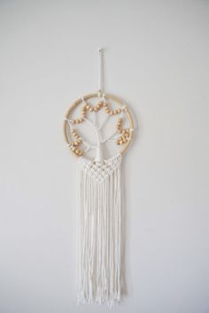 The tree of life commonly represents the interconnectedness of everything. A serene piece to add to any of your outdoor or indoor areas, reminding us of our roots. This macramé is handmade and may differ slightly in design. Wall Patterns, Tree Of Life, Serenity, Roots, Feather, Sparkle, Indoor, Range, Beach
