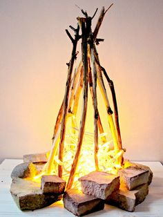 DIY Flameless Fire Pit Make a flameless fire pit for the holidays with a string of lights and some sticks and stones! DIY Flameless Fire Pit Make a flameless fire pit for the holidays with a string of lights and some sticks and stones! Camping Parties, Camping Theme, Camping Ideas, Diy Camping Decorations, Arctic Decorations, Camping Site, Camping Crafts, Camp Out Vbs, Operation Arctic