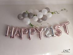 HAPPY ST Letter Balloons in color of your choice and Silver Numbers. Colors: Rose Gold, Gold, Silver Air fill only, do not use helium as the balloons will not float. Inflated with air they will not float either. The balloons are to make as a garland, lay against something, attach