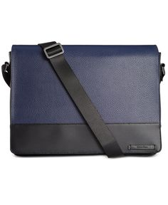 Made of rich pebble leather, this Calvin Klein messenger bag is the perfect size for keeping your essentials handsomely organized on the go. | Leather with cotton twill lining | Professionally clean |