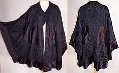 This Edwardian era antique Chinese silk soutache embroidered shawl cloak cape coat dates from 1910. It is made of a dark navy blue silk satin fabric with a cut out design and black sheer silk chiffon fabric backing lining. There is black silk braided trim raised soutache embroidery work done in an abstract pheasant feather bird design.