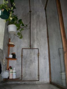 simple exposed copper pipe shower with concrete walls