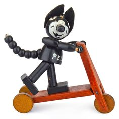 Original Felix the Cat on a scooter. Very rare vintage/antique collectible. Well-made wooden toy