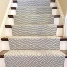 The pattern and texture of this stair runner makes the perfect impression for this home's entry. The rug is indoor/outdoor so it's perfect for this home with 3 small children and a big dog Staircase Remodel, Staircase Makeover, Foyers, Stairway Carpet, Staircase Runner, Carpet Runner On Stairs, Carpet Treads For Stairs, Pattern Carpet On Stairs, Runners For Stairs