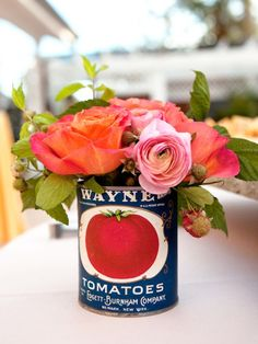 tin centerpieces - we could do THIS (like in the other photo) but instead of stationery paper, could make copies of book jackets and cover them.