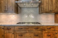 Kitchen backsplash, matte and gloss subway tiles, herringbone, knotty alder cabinets