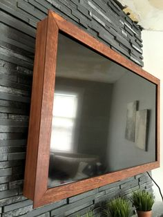 Frame a tv tutorial remodelaholic tv frame tutorial diy 40 wood tv frame works for tvs that tilt and rotate too solutioingenieria Images