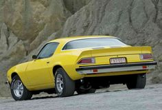 My first car - 1975 Camaro in yellow, w/spoiler, no stripes tho