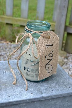 Cute idea for table at retreat. Add verse on tag and cowboy item in sand