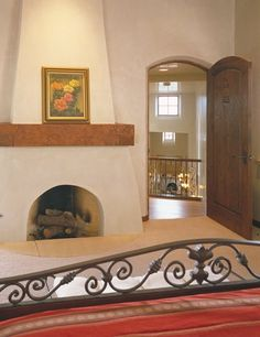 Bedroom with kiva fireplace