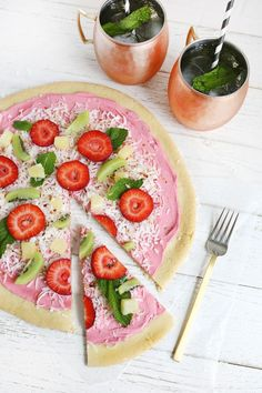 Fruit Pizza  16 oz of refrigerated sugar cookie dough (pre-made or you can use your own recipe) 8 oz strawberry cream cheese spread coconut flakes strawberries, pineapple, kiwi, or whatever fruit you want fresh mint