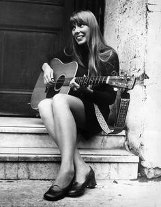 Joni Mitchell.  Wonderfully talented.  Pure vocals.  One hell of a story teller.