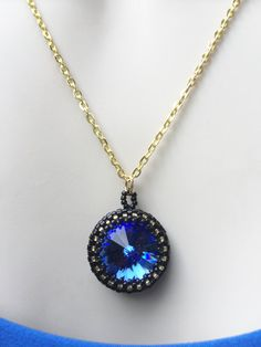 Hey, I found this really awesome Etsy listing at https://www.etsy.com/listing/385134652/blue-black-gold-pendant-necklace-beaded