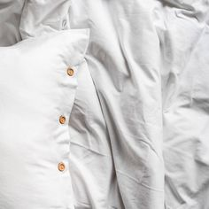 Bedding set made from very soft jersey in pure white colour. The natural fabric allows the skin to breathe and bed linen is as pleasant to the touch as your beloved t-shirt. Pillowcases and duvet have natural wooden buttons. You'll love it from the first touch. Cotton Bedding, Linen Bedding, Couple Bed, Pure White, Pillowcases, Bed Linen, Breathe, Duvet Covers, Chef Jackets