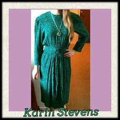 """Vintage Karin Stevens Dress 90s Karin Stevens 100% rayon work dress, mid-calf with gentle flare and center back kick pleat.  Buttons center back bodice,with zipper in skirt part. Front waistband has front flourish and back has elastic. Has shoulder pads, too.  Teal and navy. Size 8; bust to 40""""; waist 25"""" - 31""""; shoulders 16.5""""; length 45"""".  Model is 5'4"""", 36"""" bust, 27"""" waist, size 4/6 dress. Vintage Dresses Midi"""