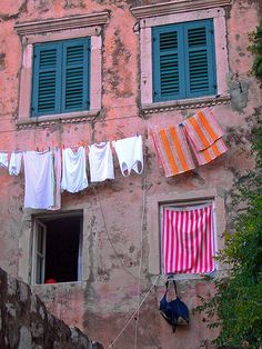 Hanging laundry on the pinkish wall of a traditional house. Dubrovnik Old Town, Southern Dalmatia, Croatia