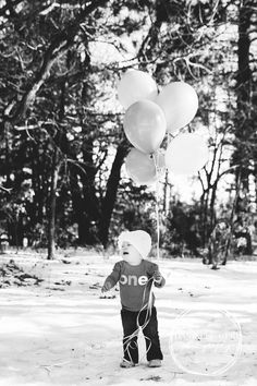 One Year Photos with Balloons. Outdoor winter baby pictures. Crying toddler photo. One year birthday photo ideas. Family photo session. Minnesota lifestyle photographer.