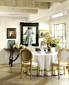 dining area, round table, neutral palette, black frame, small art