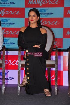 Sunny Leone interacted with the reporters present at the launch event of Manforce calendar featuring her Bollywood Celebrities, Bollywood Actress, Black Figure, In Mumbai, Sexy Curves, Celebrity Pictures, Sunnies, Calendar, Cold Shoulder Dress