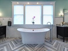 Although you might mistake the herringbone floors in this posh bathroom for wood or even a painted detail, it's actually marble that designer Joni Spear had painstakingly cut into 4-inch-wide planks then laid in a specific order to maximize the color contrast between different areas of the stone.