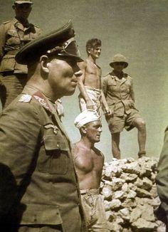 Field Marshal, Erwin Rommel, standing beside members of his Afrika Korps, N. Africa. Date taken: 1942. Photographer: Heinrich Hoffmann.
