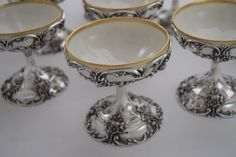 Rare Set of 8 Ornate Sterling Champagne Goblets with gold-rimmed porcelain inserts by Reidlich