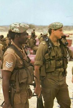 """South African Defense Force 32 Battalion troopers in They both wear Pattern 83 """"battle jackets"""", """"Transkei"""" elite camo berets, and carry folding-stock Vektor automatic rifles. Military Life, Military History, Military Gear, South African Air Force, Military Drawings, Military Special Forces, Defence Force, Military Equipment, African History"""