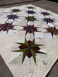 Lily's Quilts: Make with Oakshott St Louis Star tutorial by Jess Frost - paper pieced, includes link to template