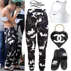 Miley Cyrus was spotted leaving a friends house in Brentwood yesterday. She wore a Nike Pro Sports Bra ($30.00), the Camouflage Printed Jersey Sweatpants by Christopher Kane ($373.04), a Chanel Heart-Shaped Vintage Bag (Sold Out) and a pair of Nike Benassi Sandals ($22.00). You can get similar sweatpants from eBay ($24.71).