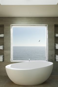 This square window frames an amazing water view. | japanesetrash.com