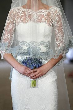 LOVE the dress and love the contrast in color! Love how the bottom lace color in the veil is the same as the color of the lace at the waist.  #carolina-herrera #bridal #lace #wedding-dress #wedding