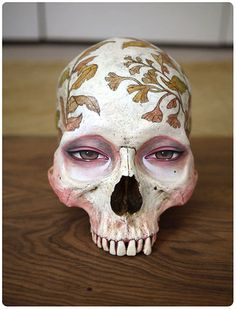 Fantastically creepy and beautiful painted skull by the ever talented Audrew Kawasaki.