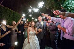 WEDDINGS – norrisphoto #norrisphoto - This fun wedding reception wanted to light up the night with some gorgeous sparklers! The bride and groom walk and dance happily beneath their memorable entrance to the party. Way to bring that extra excitement to any wedding party! #funweddingphotoideas