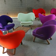 Pelican Chair | House of Finn Juhl A room full of bright chairs or (see the multi colored chair)